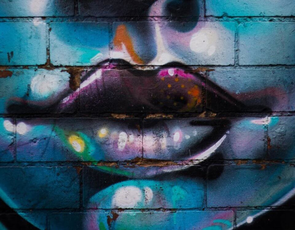 graffiti artist did the lower half of a beautiful woman's face with the emphasis on her ruby lips